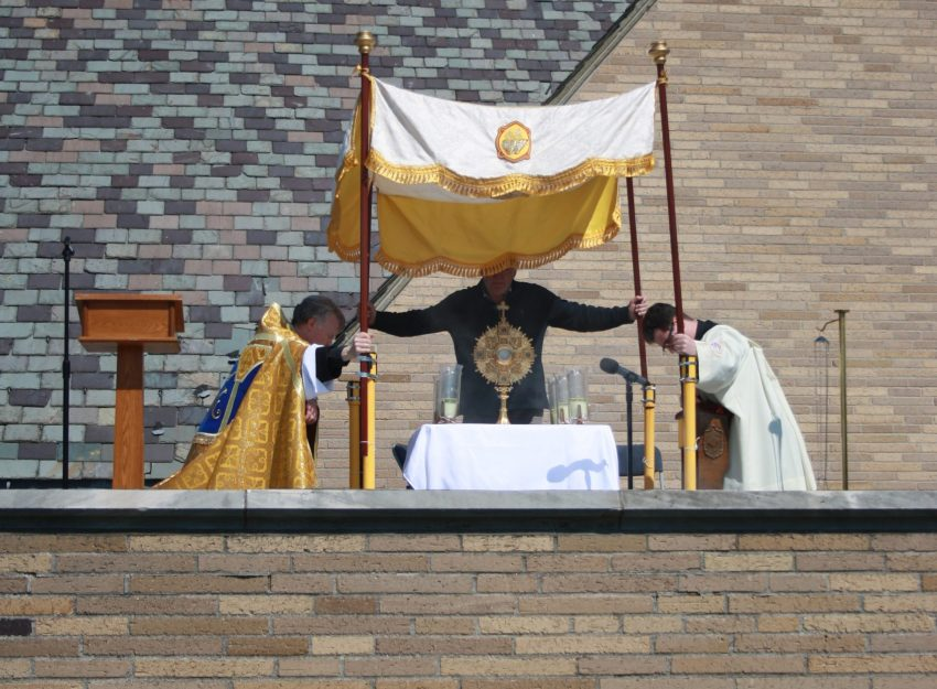FATHER BRIAN GANNON AND FATHRE FLAVIAN BEJAN FROM THE ROOFTOP AT ST. THERESA CHURCH