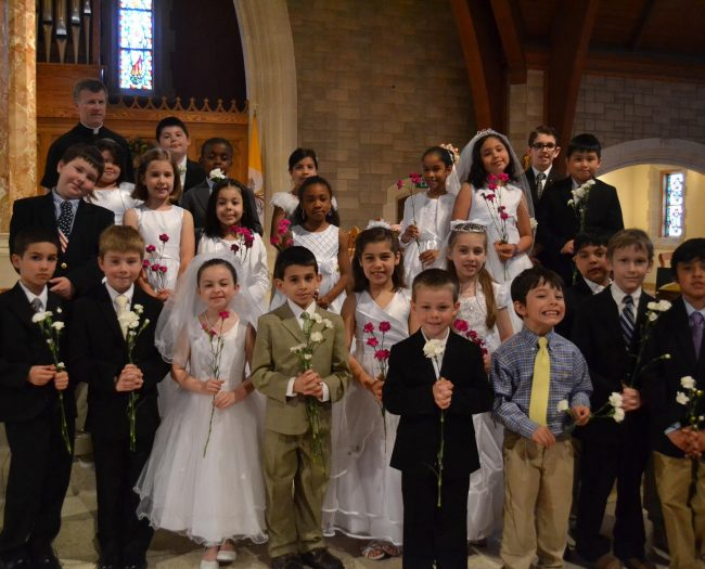 FIRST HOLY COMMUNION AT ST. THERESA CHURCH